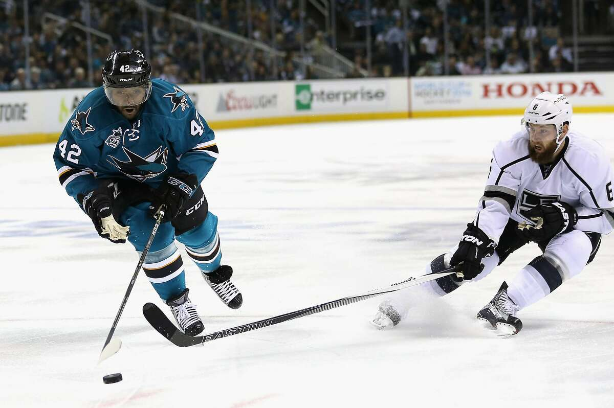SAN JOSE, CA - APRIL 20: Joel Ward #42 of the San Jose Sharks and Jake Muzzin #6 of the Los Angeles Kings go for the puck in Game Four of the Western Conference First Round during the NHL 2016 Stanley Cup Playoffs at SAP Center on April 20, 2016 in San Jose, California. (Photo by Ezra Shaw/Getty Images)