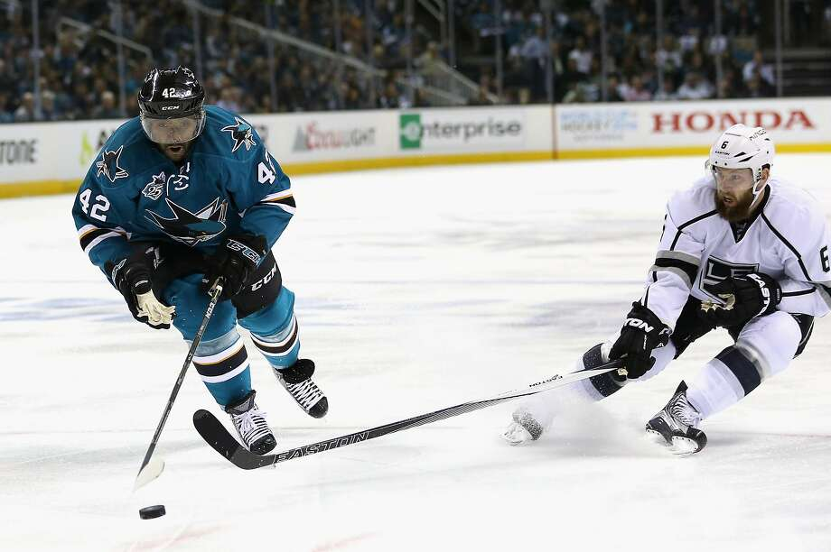 Joel Ward, left, has a history of stepping up in the playoffs and has helped lead the Sharks to their first Stanley Cup Finals. Photo: Ezra Shaw, Getty Images