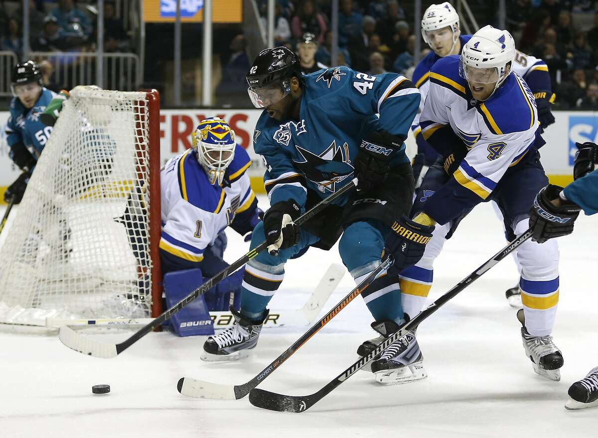 San Jose Sharks' Joel Ward (42) controls the puck against Saint Louis Blues' Carl Gunnarsson (4) in the first period at the SAP Center on Tuesday, March 22, 2016 in San Jose, Calif. (Nhat V. Meyer/Bay Area News Group/TNS)
