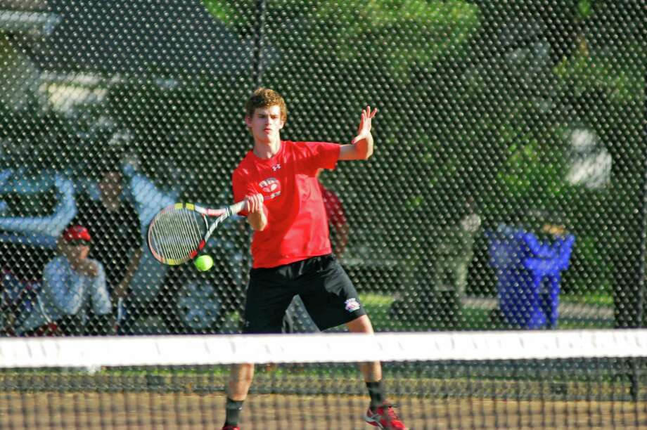 Action from the Class LL boys doubles final between Warde's Jack and Henry Johnson against Westhill's Richie Greenbaum and Jordan Soifer. Photo: Ryan Lacey/Hearst Connecticut Media / Westport News Contributed