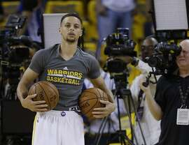 Golden State Warriors' Stephen Curry warms up before Game 1 of basketball's NBA Finals against the Cleveland Cavaliers Thursday, June 2, 2016, in Oakland, Calif. (AP Photo/Ben Margot)