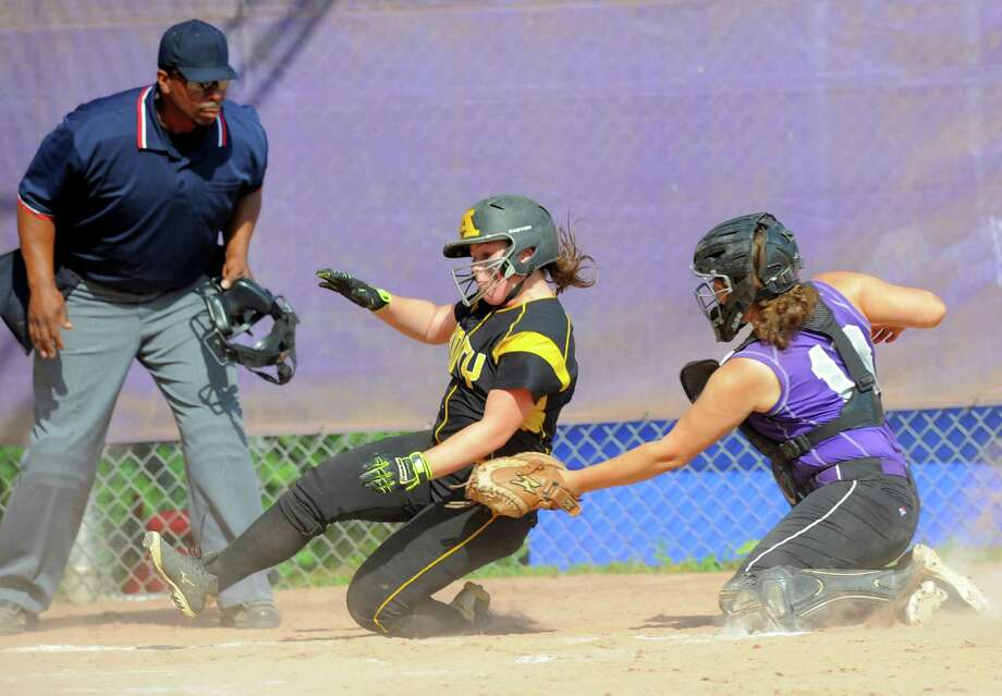 Umpire Thomas Oliver has a clear view as Westhill Jordan Benzaken puts the tag for the out on Amity Alessandra Gusmano in a CIAC Class LL Softball quarterfinal game at Westhill High School in Stamford on June 2, 2016. Amity defeated Westhill 7-0. Photo: Matthew Brown / Hearst Connecticut Media / Stamford Advocate