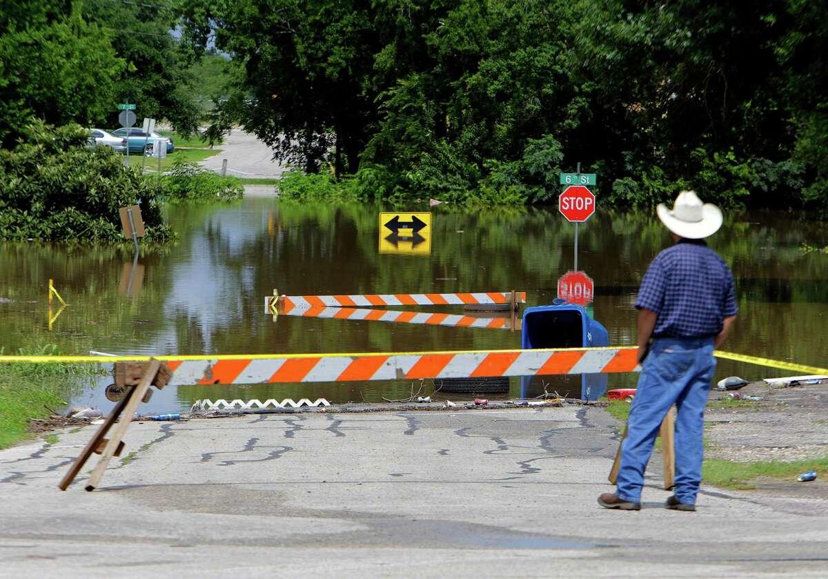 Roads along the Brazos River closed in Rosenberg on Thursday.