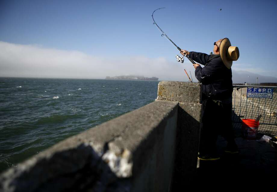 "John Macias of Concurred begins to fish in one of the few areas not blocked off due to the piers crumbling condition on Thursday, June 2, 2016 in San Francisco, Cali. ""I hope we don't fall in"" Macias jokes. Photo: The Chronicle"