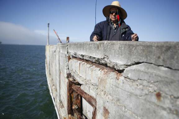 "John Macias of Concurredbegins to fish in one of the few areas not blocked off due to the piers crumbling condition on Thursday, June 2, 2016 in San Francisco, Cali. ""I hope we don't fall in"" Macias jokes."