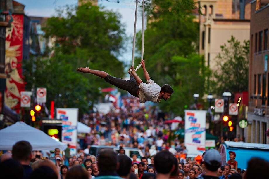 Festivalgoers need only look up to discover the performances en few feet above them. Photo: Andrew Miller