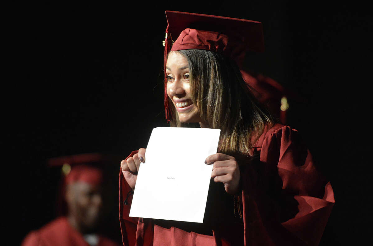 Dalis Medieta shows her diploma as she graduates with the Norwalk Adult Education Class of 2016 at Brien McMahon High School on Thursday June 2, 2016 in Norwalk Conn.