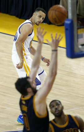 Golden State Warriors' Stephen Curry watches Cleveland Cavaliers' Kevin Love rebound Curry's missed 3-point attempt in 2nd quarter of Game 1 of NBA Finals at Oracle Arena in Oakland, Calif., on Thursday, June 2, 2016.
