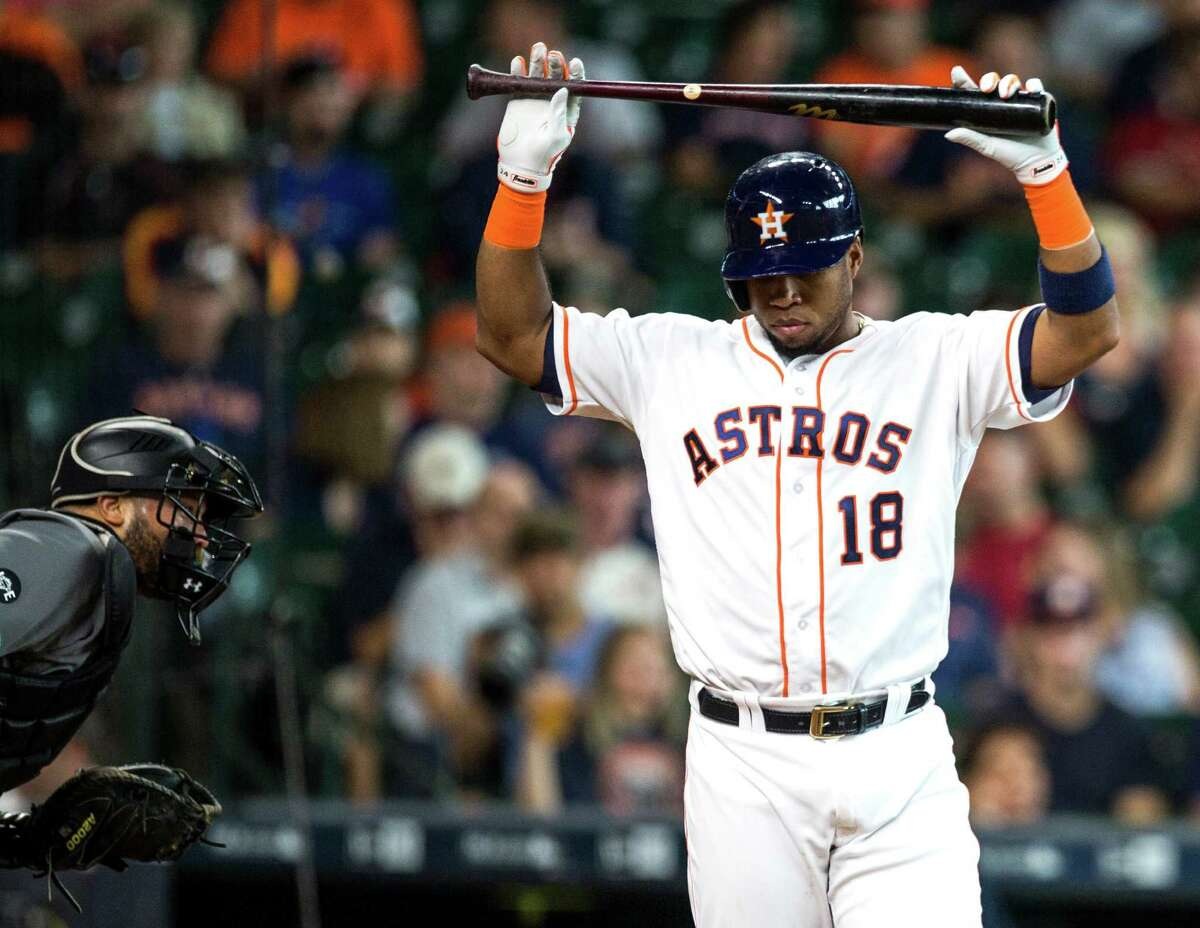 Astros third baseman Luis Valbuena appears to be mulling whether to break his bat after striking out against Diamondbacks ace Zack Greinke in the second inning Thursday at Minute Maid Park.
