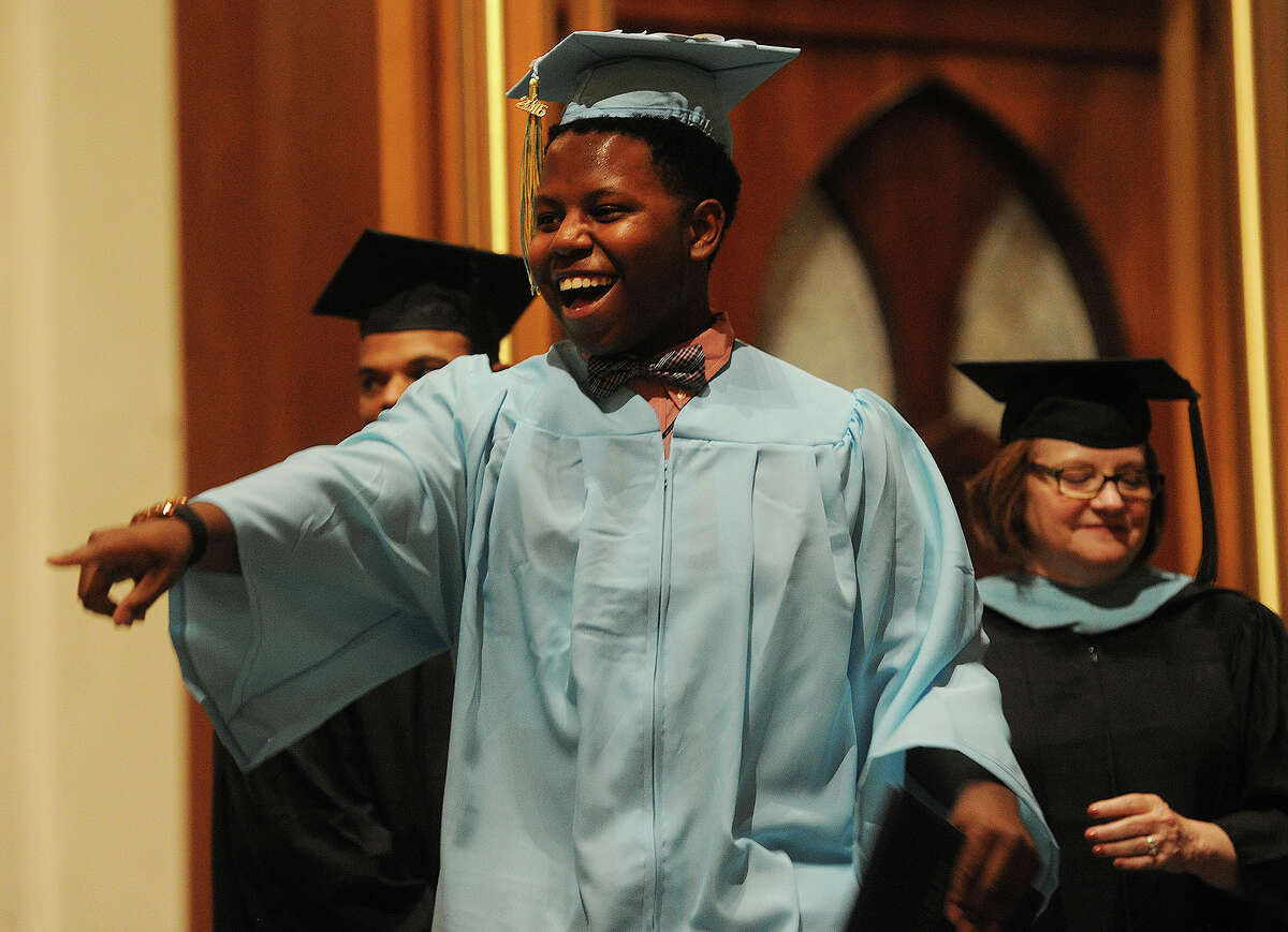 Graduate Nicholas Michel celebrates after receiving his diploma at Saint Augustine Cathedral in Bridgeport, Conn. on Thursday, June 2, 2016.