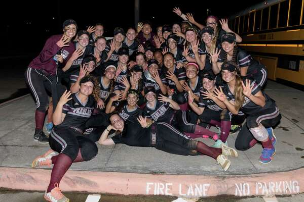 The Pearland Lady Oilers pose for a photo after defeating the Deer Park Lady Deer two out of three games to win the Regional Quarterfinals on Friday, May 13, 2016 at the Dawson High School ballpark.