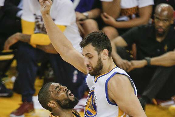 Cleveland Cavaliers' Kyrie Irving runs into Golden State Warriors' Andrew Bogut in the second quarter during Game 1 of the NBA Finals at Oracle Arena on Thursday, June 2, 2016 in Oakland, Calif.