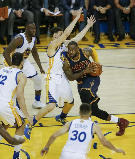 Klay Thompson gets help from teammates defending against LeBron James during Game 1 on Thursday night. Photo: Michael Macor, The Chronicle