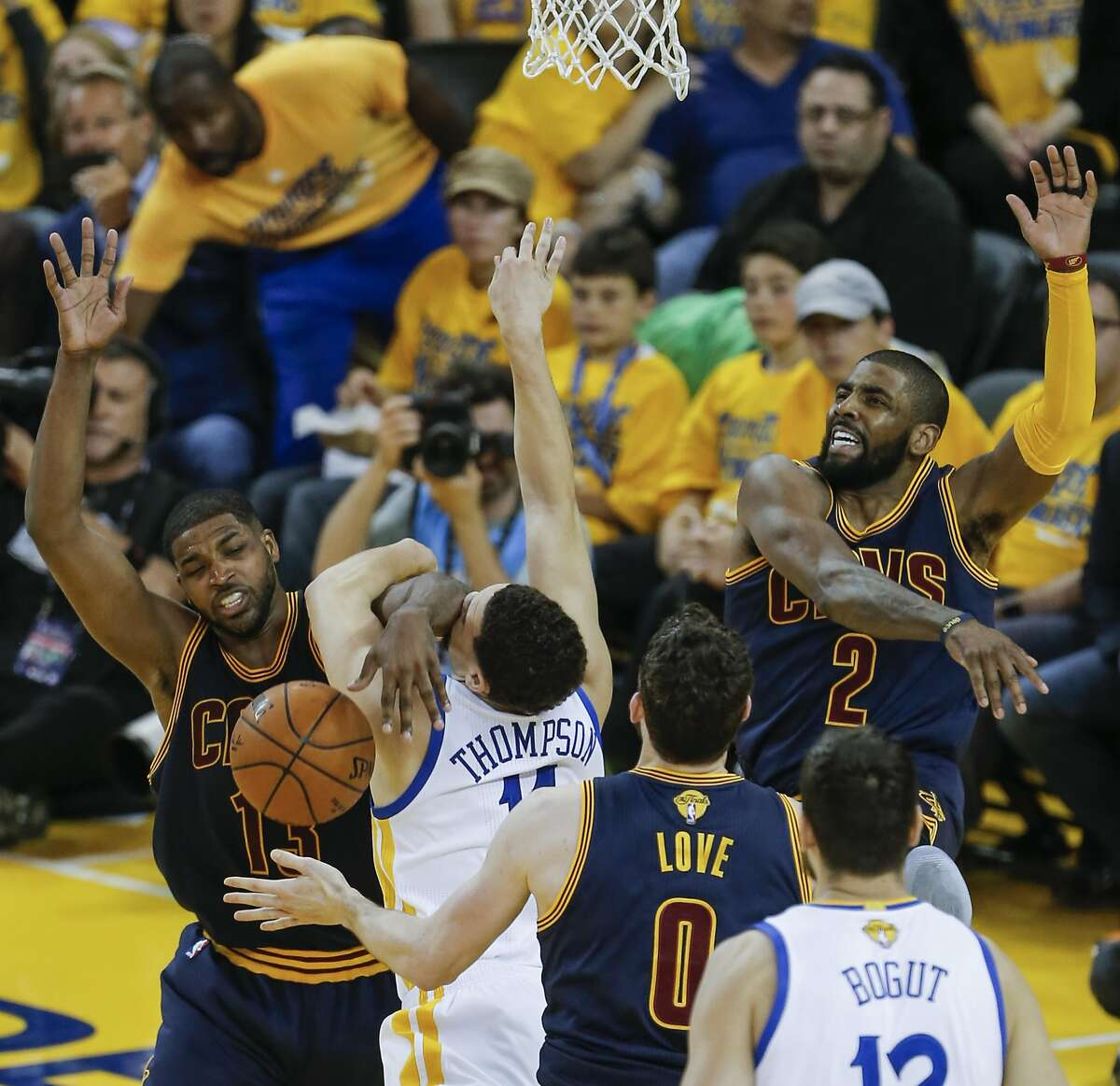 Cleveland Cavaliers' Tristan Thompson and Golden State Warriors' Klay Thompson fight for a rebound in the third quarter during Game 1 of the NBA Finals at Oracle Arena on Thursday, June 2, 2016 in Oakland, Calif.