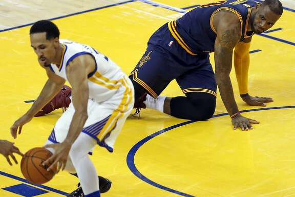 Cleveland Cavaliers' LeBron James watches as Golden State Warriors' Shaun Livingston corrals a James' turnover in 4th quarter of Warriors' 104-89 win in Game 1 of NBA Finals at Oracle Arena in Oakland, Calif., on Thursday, June 2, 2016.