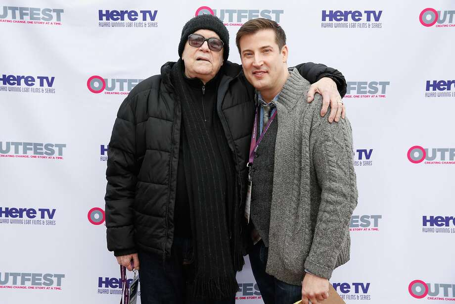 Robert Hawk (left) with a guest at the Sundance Film Festival, will be honored at a Frameline screening of a film about his life. Photo: Rick Kern, Getty Images For Outfest