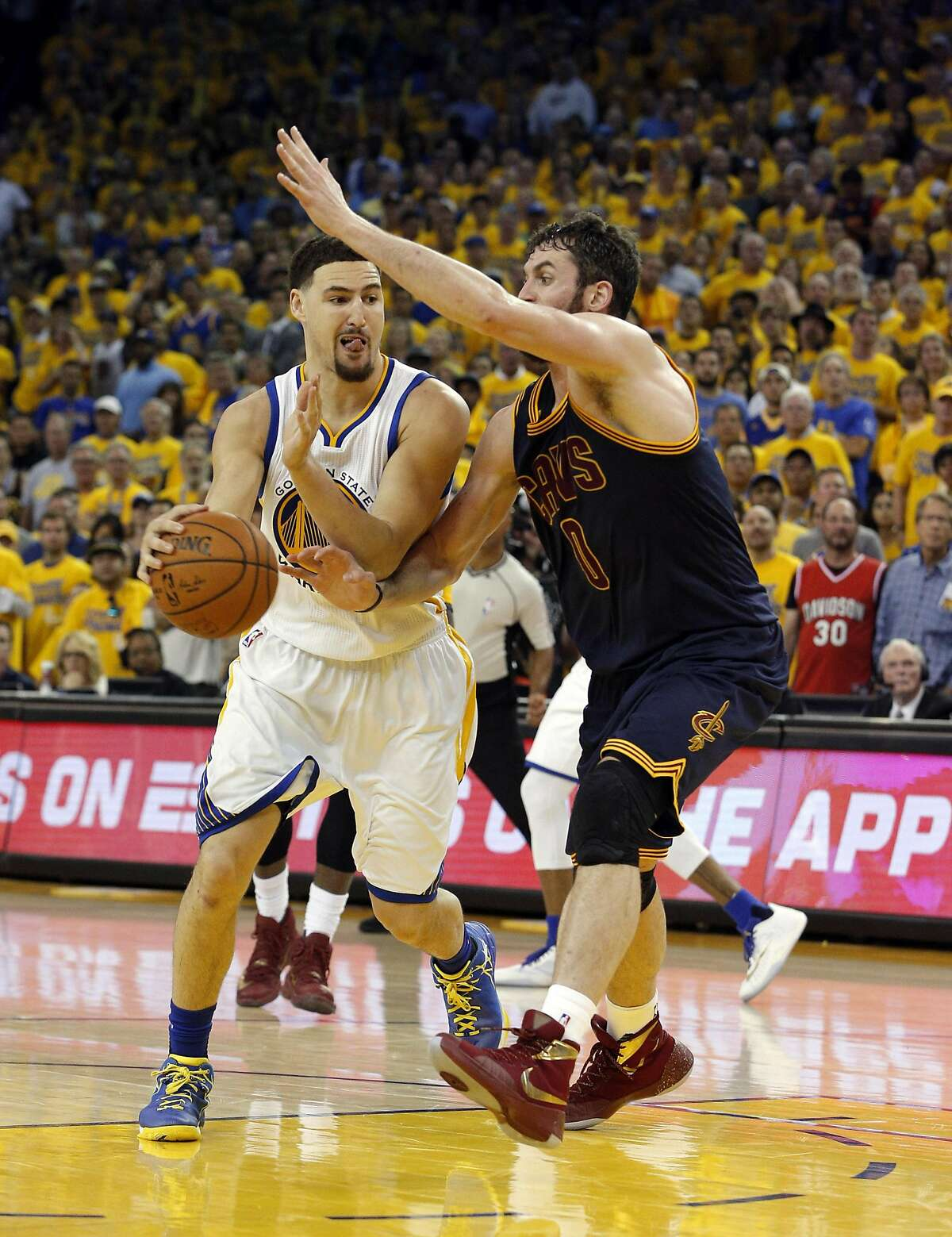 Klay Thompson (11) drives around a defeding Kevin Love (0) in the second half as the Golden State Warriors played the Cleveland Cavaliers in Game 1 of the NBA Finals at Oracle Arena in Oakland on June 2, 2016. The Warriors defeated the Cavaliers 104-89.