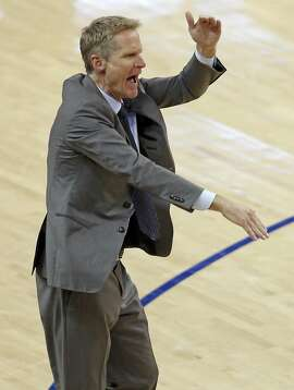 Golden State Warriors' head coach Steve Kerr looks for a foul call in 3rd quarter of Warriors' 104-89 win over Cleveland Cavaliers in Game 1 of NBA Finals at Oracle Arena in Oakland, Calif., on Thursday, June 2, 2016.