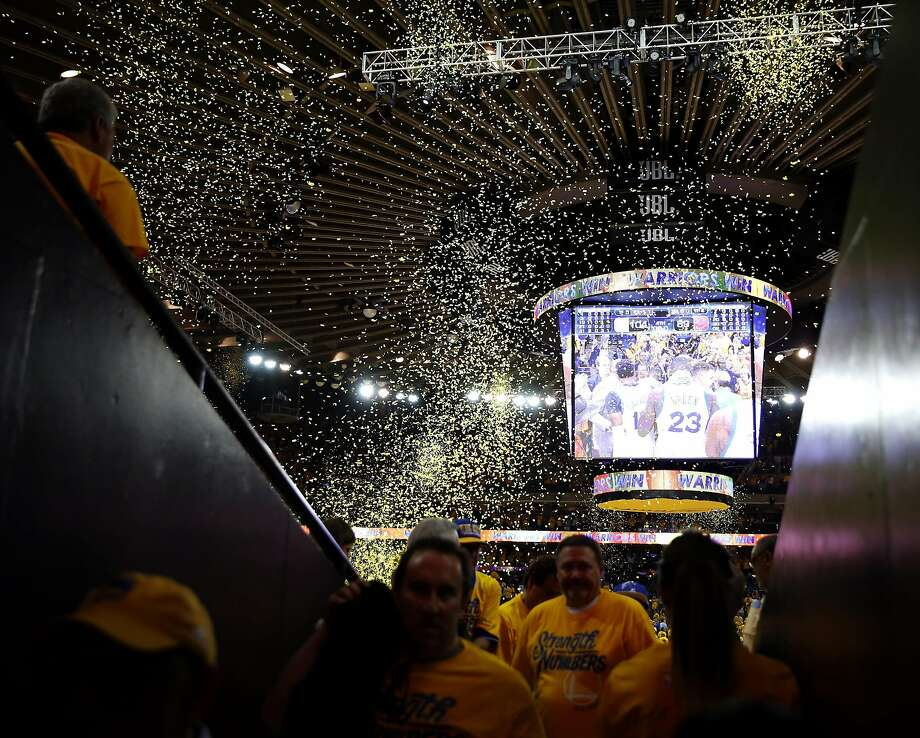 Confetti falls after the Warriors won Game 1 of the NBA Finals against the Cleveland Cavaliers at Oracle Arena in Oakland, California, on Thursday, June 2, 2016. Photo: Connor Radnovich, The Chronicle