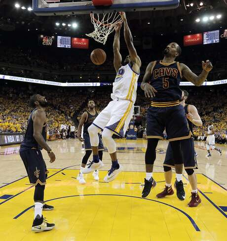 Andre Iguodala (9) dunks in the first half as the Golden State Warriors played the Cleveland Cavaliers in Game 1 of the NBA Finals at Oracle Arena in Oakland, Calif., on Thursday, June 2, 2016. The Warriors defeated the Cavaliers 104-89. Photo: Carlos Avila Gonzalez, The Chronicle