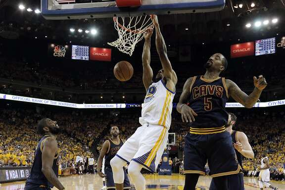 Andre Iguodala (9) dunks in the first half as the Golden State Warriors played the Cleveland Cavaliers in Game 1 of the NBA Finals at Oracle Arena in Oakland, Calif., on Thursday, June 2, 2016. The Warriors defeated the Cavaliers 104-89.