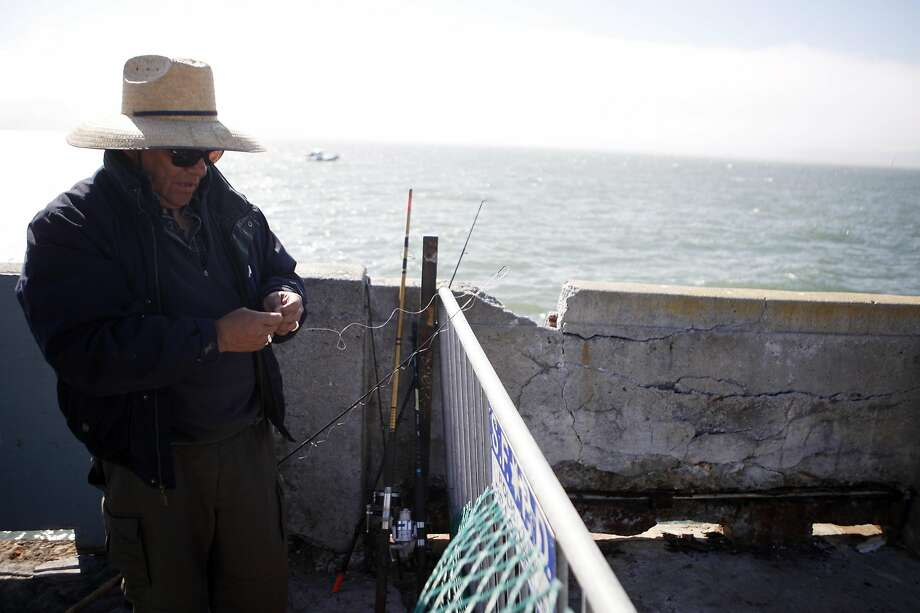 John Macias of Concord takes in the view from the Municipal Pier. Photo: Michael Noble Jr., The Chronicle