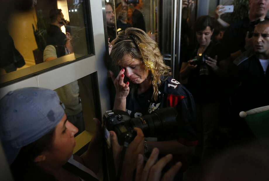 A Donald Trump supporter tries to clear her eyes after being cornered by an anti-Trump crowd and getting hit by multiple eggs near the convention center where presidential candidate Donald Trump held a campaign rally June 2, 2016 in downtown San Jose, Calif. Photo: Leah Millis, The Chronicle
