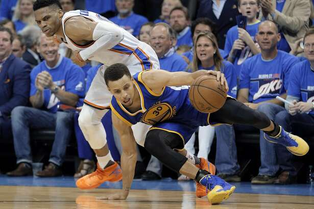 Stephen Curry (30) is fouled by Russell Westbrook (0) during the second half as the Golden State Warriors played the Oklahoma City Thunder in Game 3 of the Western Conference Finals at Chesapeake Energy Arena in Oklahoma City, Okla., on Sunday, May 22, 2016.