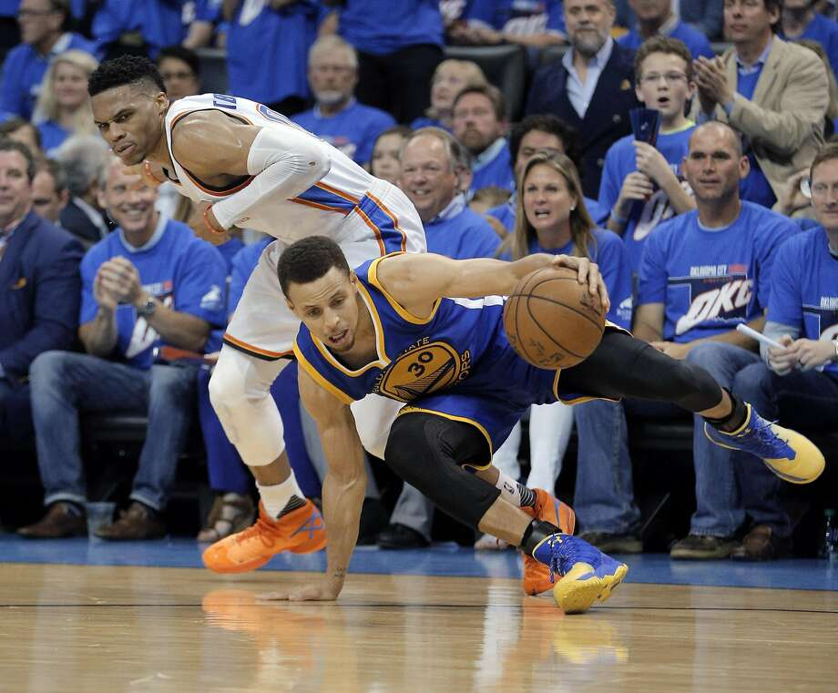Stephen Curry (30) is fouled by Russell Westbrook (0) during the Western Conference Finals in 2016. Kevin Durant, former teammate of both players, was asked who was better, Westbrook or Curry?, on Serge Ibaka's cooking show. Photo: Carlos Avila Gonzalez, The Chronicle