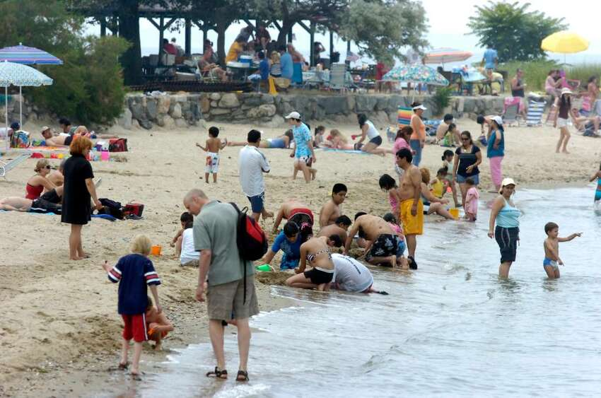 Crowds flock to Island Beach to kick off the holiday weekend grilling and swimming.