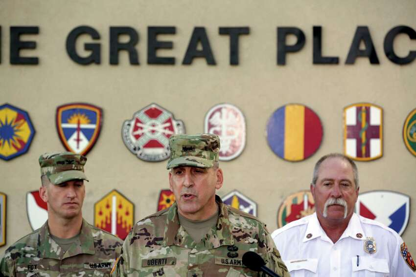 Maj. Gen. John Uberti, deputy commander of Fort Hood, updates the media about soldiers who were killed and others who are still missing after their tactical vehicle was swept away by swiftly moving floodwaters on a training range June 2, 2016. With Hberti is Col. Todd Fox (left) and Fire Chief Coleman Smith.