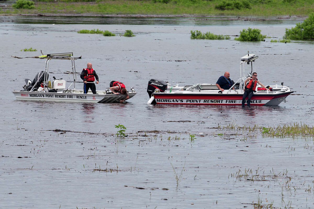 Members of Morgan's Point Resort Fire and Rescue work on Lake Belton near the scene of an accident at Fort Hood at Owl Creek Park near Gatesville on June 2, 2016. Fort Hood officials said Friday five soldiers are dead, four are missing and three were rescued after an Army troop truck was washed from a low-water crossing and overturned in a rain-swollen creek at Fort Hood about 11:30 a.m.