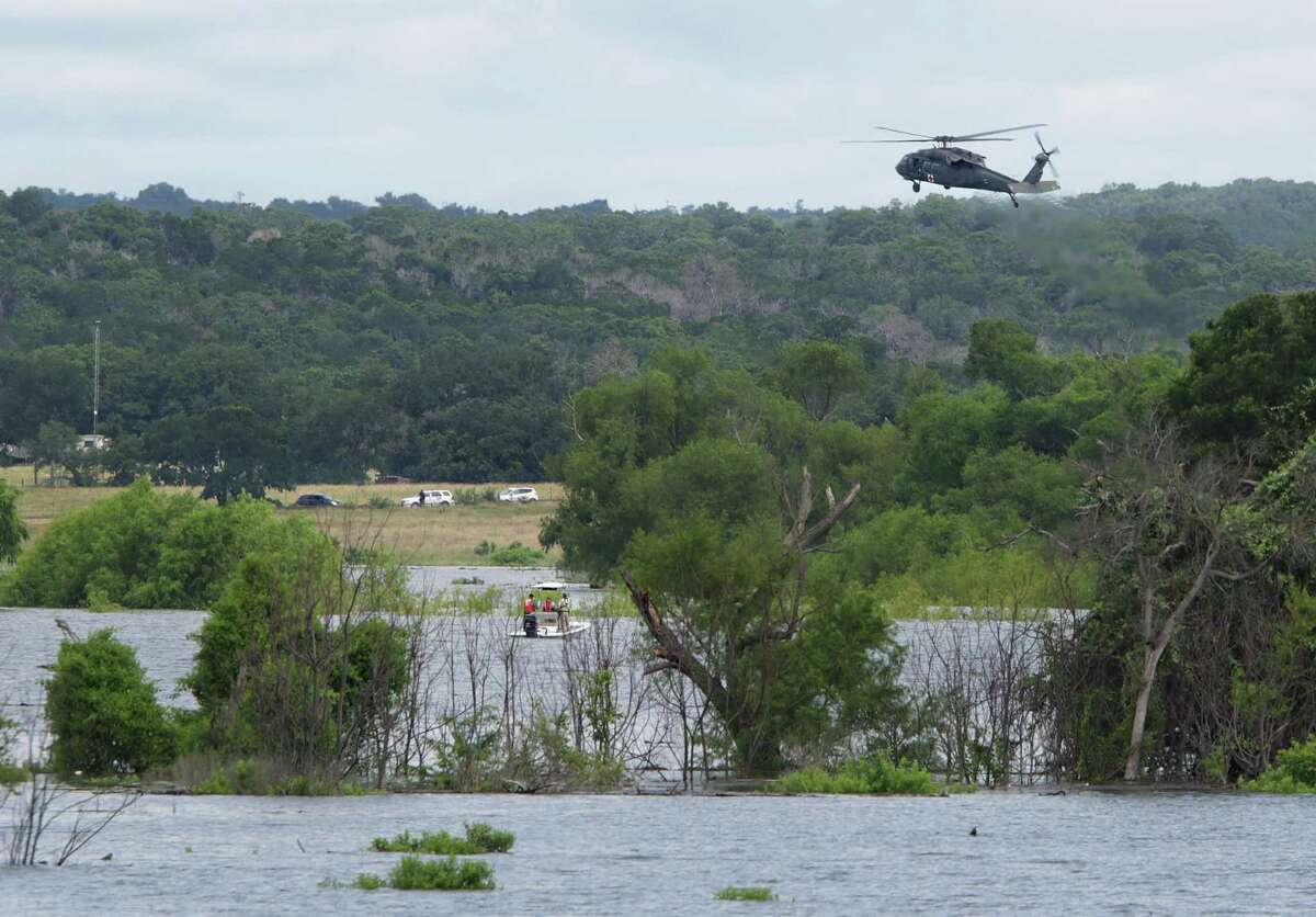 Search parties by helicopters and boats search Lake Belton Lake in between Kileen and Temple, Texas on Friday, June 3, 2016, for the remaining missing soldiers that were washed away in floods yesterday at Fort Hood.
