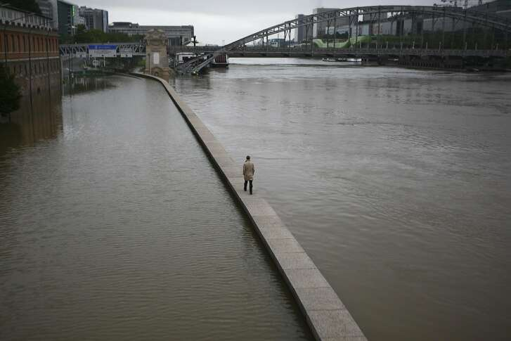 Flooding along the banks of the Seine River in Paris, June 3, 2016. The Louvre Museum and the Musee d�Orsay relocated masterpieces from rooms vulnerable to flooding, and cultural institutions across the French capital turned away tourists, as continuing rains on Friday lifted the Seine to its highest levels since 1982. (Pierre Terdjman/The New York Times)