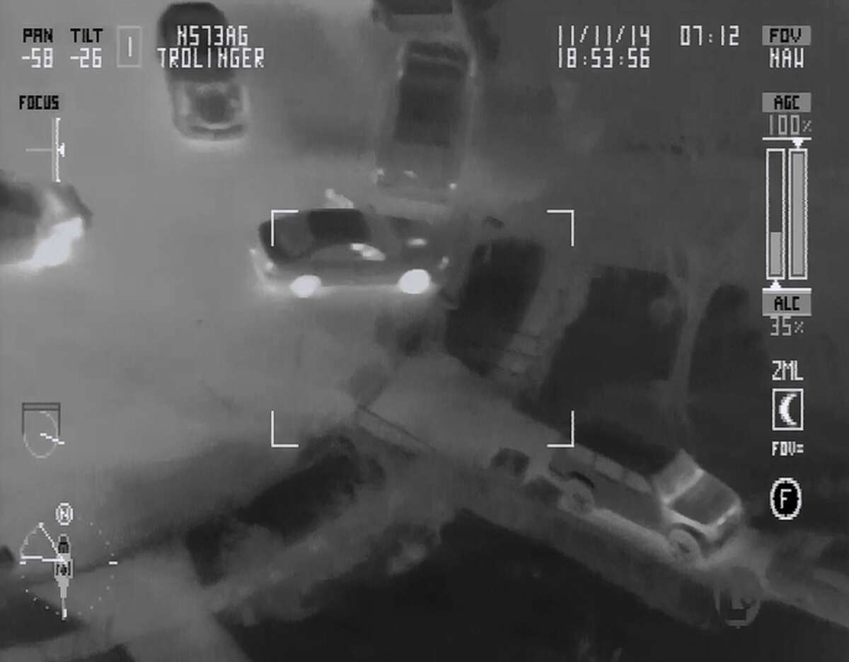 Video footage from a San Antonio Police helicopter shows an SAPD officer kicking a suspect who was on the ground with his hands raised. The incident was from Nov. 10, 2014, and the officer involved was suspended for two days.