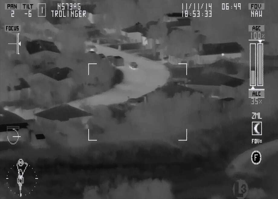 Video footage from a San Antonio Police helicopter shows an SAPD officer kicking a suspect who was on the ground with his hands raised. The incident was from Nov. 10, 2014, and the officer involved was suspended for two days. Photo: Courtesy SAPD