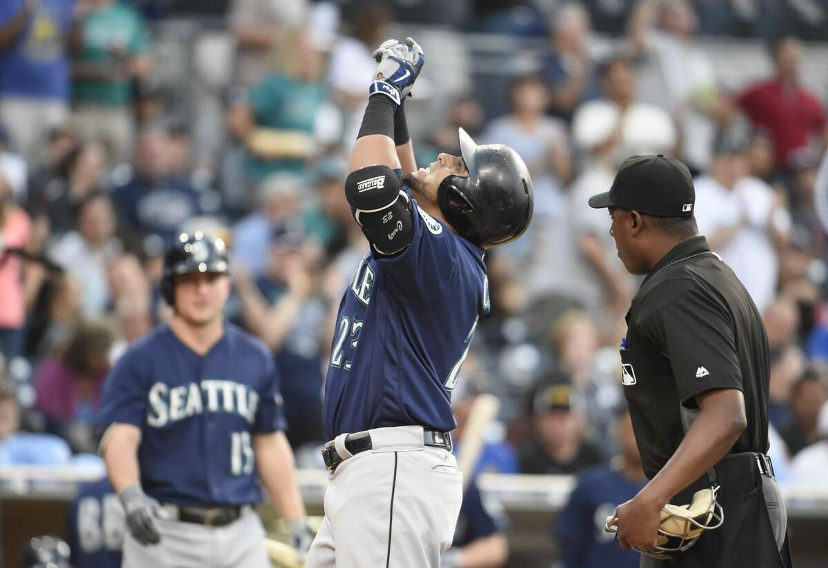 Nelson Cruz of the Seattle Mariners points skyward after hitting a solo home run during the fourth inning of a baseball game against the San Diego Padres at PETCO Park on June 2, 2016 in San Diego, California. (Photo by Denis Poroy/Getty Images)