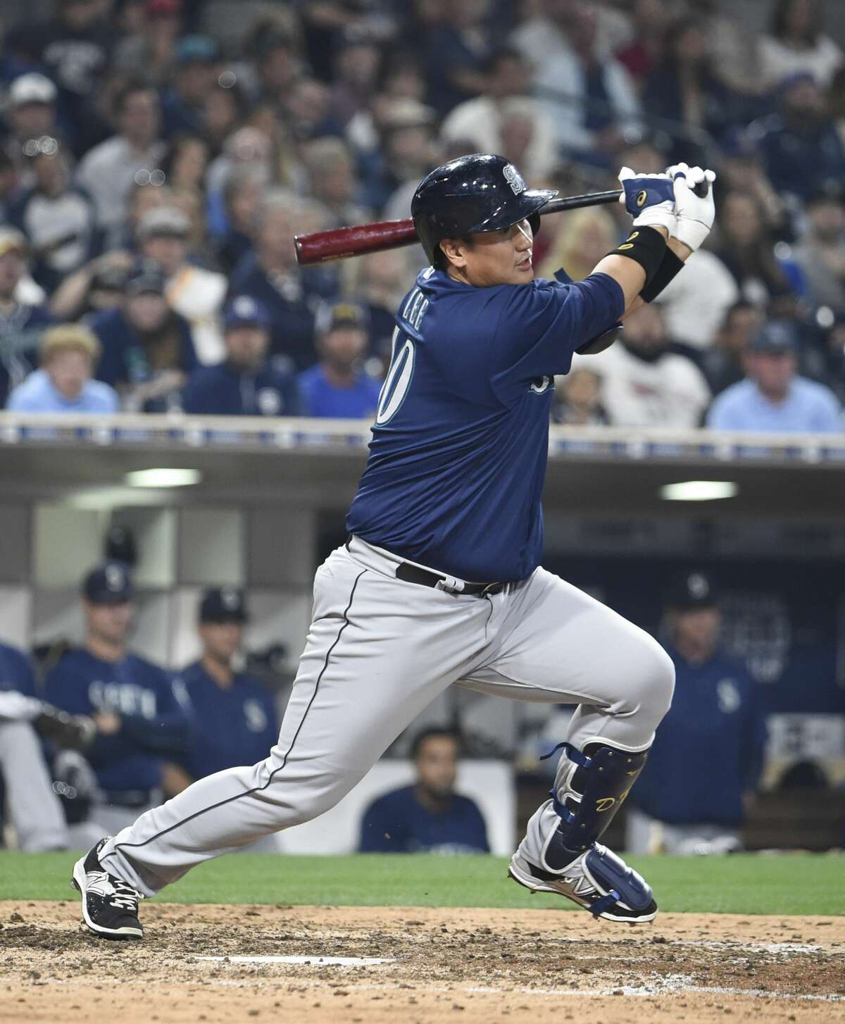 Dae-Ho Lee of the Seattle Mariners hits an RBI single during the seventh inning of a baseball game against the San Diego Padres at PETCO Park on June 2, 2016 in San Diego, California. (Photo by Denis Poroy/Getty Images)