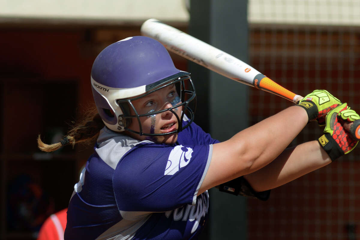 Angleton senior first baseman/pitcher Lindsey Honeycutt follows her drive to centerfield in the top of the 4th inning against Gregory-Portland in their Class 5A semifinal matchup at the 2016 UIL Softball State Championships at McCombs Field in Austin on Friday, June 3, 2016. (Photo by Jerry Baker/Freelance)