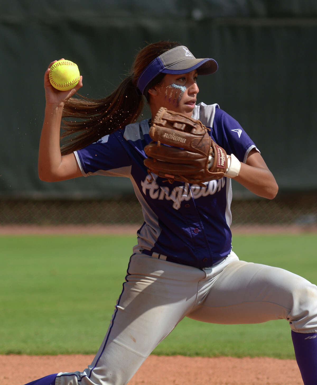 Angleton junior shortstop Brianna Cantu makes a play to second baseman Mackenzie Kotrla in the bottom of the 4th inning of the Wildcats Class 5A semifinal matchup with Gregory-Portland at the 2016 UIL Softball State Championships at McCombs Field in Austin on Friday, June 3, 2016. (Photo by Jerry Baker/Freelance)