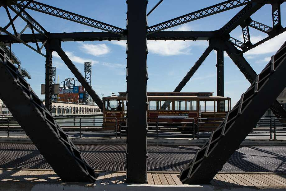 A cable car with wheels crosses the Third Street drawbridge, which is scheduled to be closed for a major overhaul next year. Photo: Amy Osborne, Special To The Chronicle