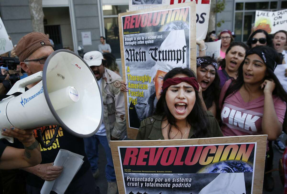 Anti-Trump protester Miriam Espinoza, 16, of San Jose, chants with others near the convention center before presidential candidate Donald Trump held a campaign rally June 2, 2016 in downtown San Jose, Calif.