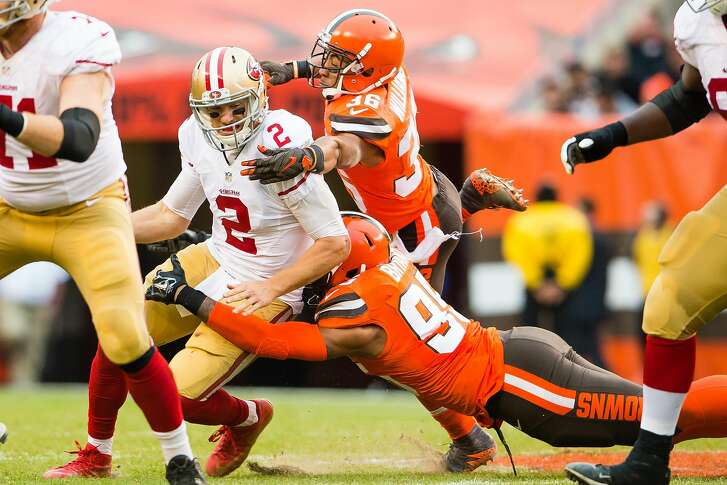 CLEVELAND, OH - DECEMBER 13: Quarterback Blaine Gabbert #2 of the San Francisco 49ers is sacked by outside linebacker Armonty Bryant #95 and free safety K'Waun Williams #36 of the Cleveland Browns during the second half at FirstEnergy Stadium on December 13, 2015 in Cleveland, Ohio. The Browns defeated the 49ers 24-10. (Photo by Jason Miller/Getty Images)
