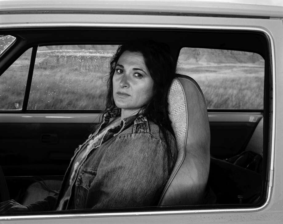 "Judy Dater's ""Self Portrait in Car 1982."""