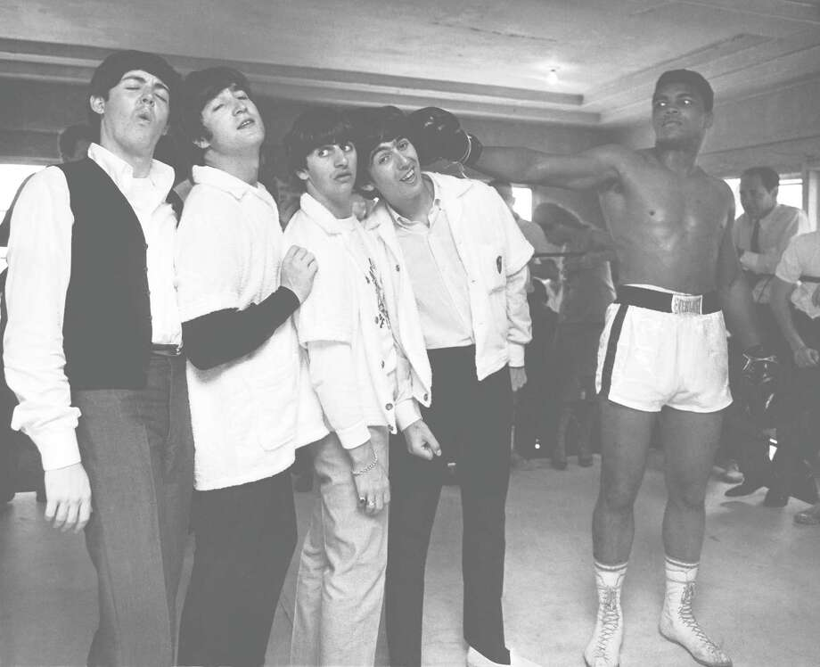 """Harry Benson: Shoot First"" profiles photographer Harry Benson whose famous images include pairing The Beatles with Muhammad Ali in the boxer's Miami gym while the British rock group was making its first U.S. tour in 1964. Photo: Contributed Photo / Connecticut Post Contributed"