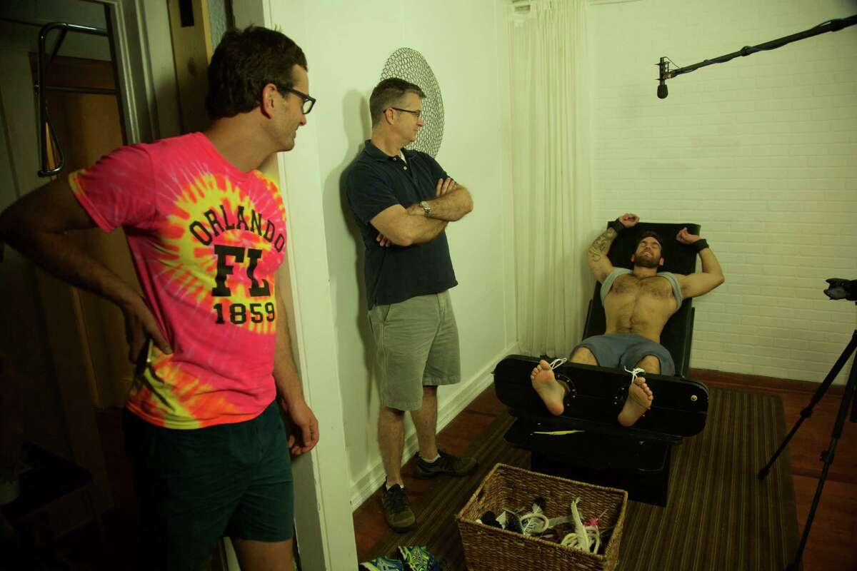 """New Zealand journalist David Farrier, left, explores the underground world of """"competitive endurance tickling"""" and its connection to cyber blackmail in the new documentary """"Tickled"""" that will be screened at the Greenwich International Film Festival."""