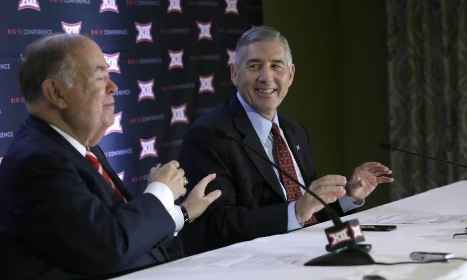 Commissioner of the Big 12 Bob Bowlsby, right, and University of Oklahoma President David Boren share a laugh while speaking to reporters at the Big 12 sports conference meetings in Irving, Texas, Thursday, June 2, 2016. (AP Photo/LM Otero) Photo: Associated Press