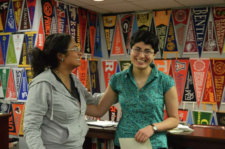 At HISD's Bellaire High School, senior Mojdeh Yadollahikhales, right, tells how she got ready to apply to college with help from counselor Rachael Faith. Photo: Andrew Kragie