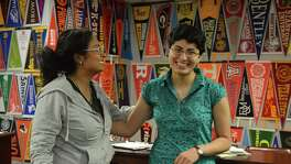 At HISD's Bellaire High School, senior Mojdeh Yadollahikhales, right, tells how she got ready to apply to college with help from counselor Rachael Faith.