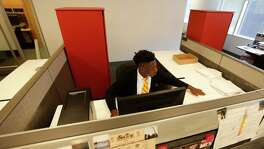 Cristo Rey high school senior, Matthew Carmon, 18, works on the computer at the EnerVest office, Monday, May 16, 2016, in Houston.  Cristo Rey students work at EnerVest one day a week each, and their income from the job helps offset tuition costs. ( Karen Warren  / Houston Chronicle )